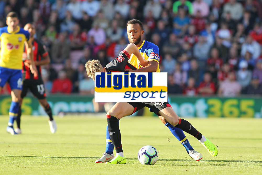 Football - 2018 / 2019 Premier League - AFC Bournemouth vs. Southampton<br /> <br /> Southampton's Ryan Bertrand holds onto Bournemouth's David Brooks during the Premier League match at the Vitality Stadium (Dean Court) Bournemouth   <br /> <br /> COLORSPORT/SHAUN BOGGUST
