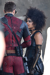 Ryan Reynolds joins Zazie Beetz back on set filming action scenes for Deadpool 2. Ryan was seen in-between takes wearing the deadpool costume with no mask on and sunglasses. Ryan chatted to Zazie Beetz as she arrived on set and prepared for filming as other cast including Colossus was seen filming in downtown Vancouver. Deadpool 2 production had been on hold while the investigation into a fatality on set involving a stunt woman for Zazie Beetz. 16 Aug 2017 Pictured: Ryan Reynolds, Zazie Beetz. Photo credit: Atlantic Images/ MEGA TheMegaAgency.com +1 888 505 6342