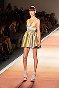 A yellow and silver min-dresss with halter top.