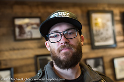 Custom motorcycle builder Andy Carter at West Ride Clothing on a Tokyo shop tour with BMW after Mooneyes. Japan. December 8, 2015.  Photography ©2015 Michael Lichter.