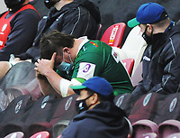 Rugby Union - 2020 / 2021 European Rugby Challenge Cup - Round of 16 - London Irish vs Cardiff - Brentford Community Stadium<br /> <br /> Will Goodrick - Clarke of London Irish holds his head in his hands in the stands after receiving the Red card from referee, <br /> <br /> Credit  COLORSPORT/ANDREW COWIE