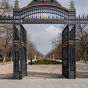 Madrid, Spain - February 17, 2018 - The Parque de Madrid entrance to Buen Retiro Park. The 350 acre park is located near Museo de Prado and belonged to the Spanish Monarchy until the late 19th century. <br /> <br /> Image: © Rod Mountain http://www.rodmountain.com<br /> <br /> Nikon D800 / Nikkor Lens @nikoncanada #NikonCA @NikonUSA #NikonNoFilter @nikoneurope #NikonEurope<br /> <br /> https://en.wikipedia.org/wiki/Parque_del_Buen_Retiro,_Madrid<br /> https://www.esmadrid.com/en/tourist-information/parque-del-retiro<br /> #Spain #TourismSpain #VisitSpain #wonderlust.spain <br /> https://www.spain.info/en/ @spain @spain.info <br /> @visita_madrid @visitamadridoficial @Visita_Madrid<br /> <br /> #somewheretravels #ignanttravel #monoart #bwmasters #blacknwhitepic #bw_society #bwoftheday #blackandwhitephotography #welltravelled #travelmemories #blackandwhiteonly #bnw_life #bnw_city #travelphotography #trip #getaway #tourism #travelblog#instago #mytravelgram#travelingram #park #retiropark