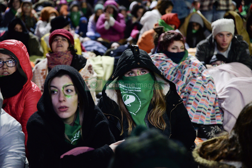 June 14, 2018 - INT. WorldNews. 2018, June 13. City of Buenos Aires, Argentina.- Thousands of people manifestate in front of the National Congress in favor (green handkerchief) and against (blue) the Legalization of Abortion Project, while lawmakers debate inside the National Congress  (Credit Image: ©  via ZUMA Wire)