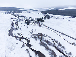 Dalwhinnie, Scotland, UK. 6 May 2021. Aerial view of snow covered landscape in the high altitude Drumochter Pass at Dalwhinnie in the Scottish highlands. Pic; The village of Dalwhinnie in a snow covered landscape. Iain Masterton/Alamy Live News