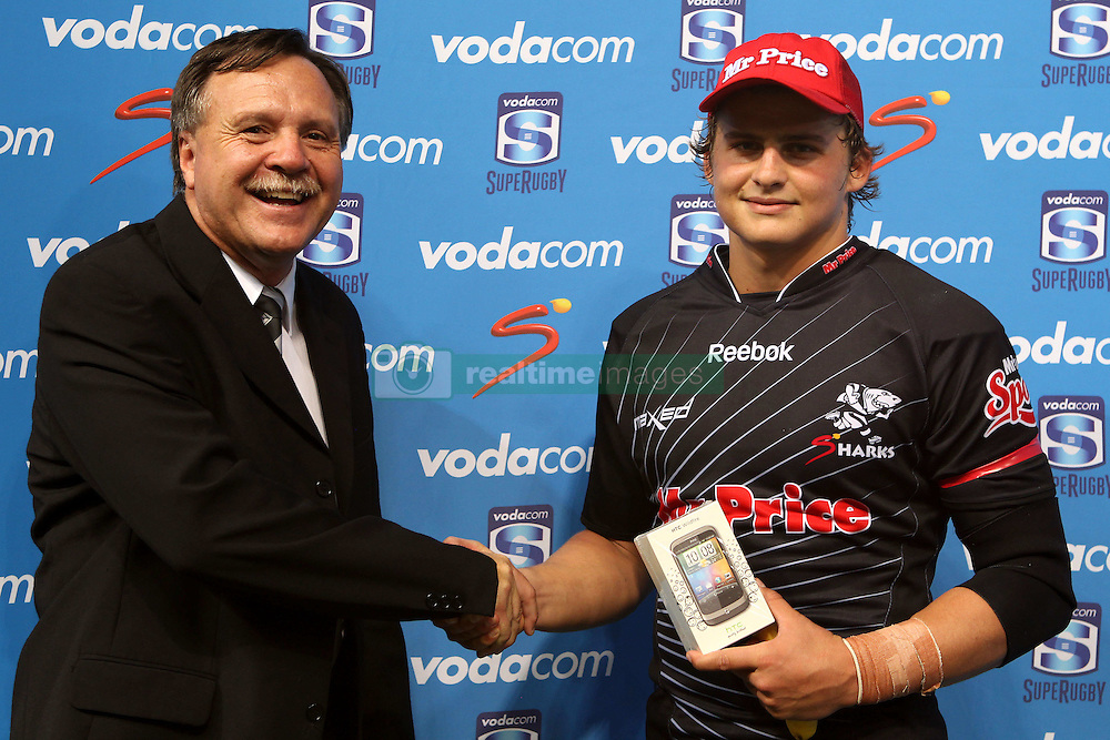Patrick Lambie of The Sharks receives the man of the match award during the Super15 match between The Mr Price Sharks and The Blues held at Mr Price Kings Park Stadium in Durban on the 26th February 2011..Photo By:  Ron Gaunt/SPORTZPICS