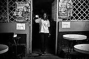 Priscilla, aged 26, at local bar 'Bobs' in Mugumoini Village slum where she works as a waitress when she is not seeing clients as a prostitute. Raped by 2 men on her way home one night after a party with friends she was left abandoned on the roadside, drunk and naked. A woman from the Kenya Wildlife Service found her the next day and took her home. She has continuous health problems as a result forcing her to make regular visits to the local community health centre. She has been an inspiration to other raped women in the community and continues to come forward.<br /> This image is from a series focusing on and around the rape and the women victims that occur every half a day in Mugumoini Village in Nairobi's Southlands, a slum home to 20,000 people in abject poverty with little or no income, with the aim of creating exposure and empowerment for change. ©GGoodwin