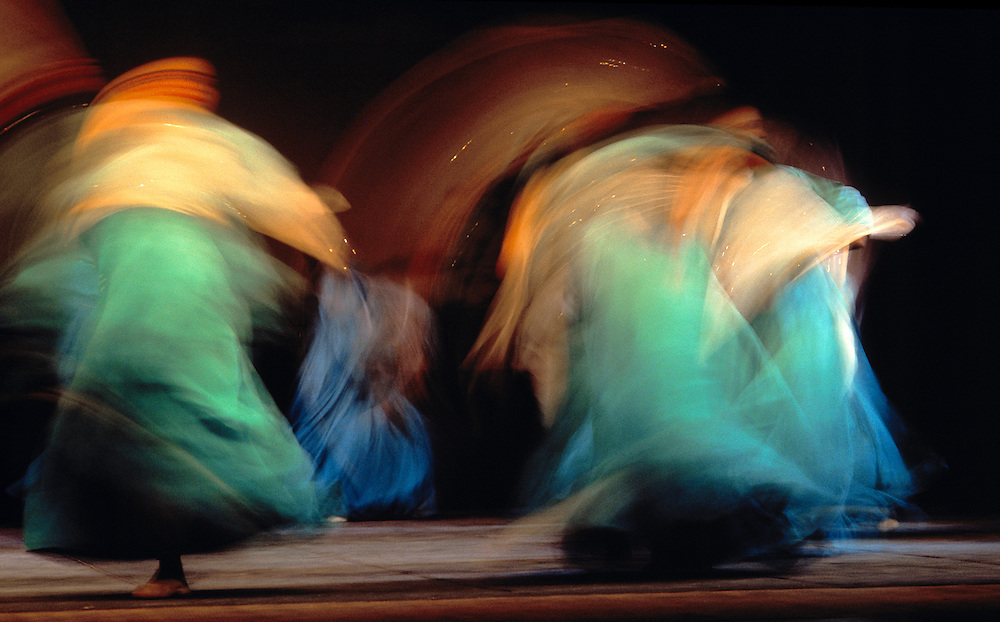 A slow shutter speed accents the whirling movements of a Peking Opera dance troupe in Xian, China.
