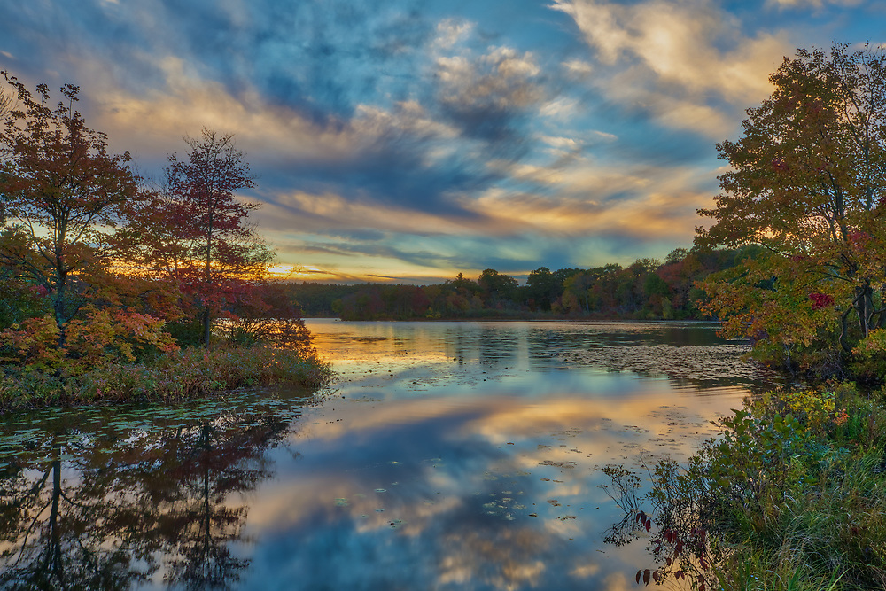 New England fall foliage and sunset photography from Lake Waban in Wellesley, Massachusetts. This Massachusetts lakes is a nearby inspiration and makes for a beautiful New England outdoor location to visit and to also get lost with a camera.<br /> <br /> Wellesley sunset photos are available as museum quality photo, canvas, acrylic, wood or metal prints. Wall art prints may be framed and matted to the individual liking and wall art décor project needs:<br /> <br /> https://juergen-roth.pixels.com/featured/my-guiding-light-juergen-roth.html<br /> <br /> Good light and happy photo making!<br /> <br /> My best,<br /> <br /> Juergen<br /> Photo Prints & Licensing: http://www.rothgalleries.com<br /> Photo Blog: http://whereintheworldisjuergen.blogspot.com<br /> Instagram: https://www.instagram.com/rothgalleries<br /> Twitter: https://twitter.com/naturefineart<br /> Facebook: https://www.facebook.com