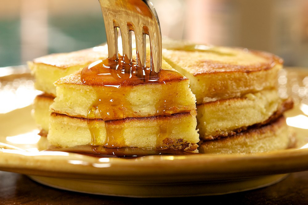 Pancakes drizzled with Crown Maple Syrup.