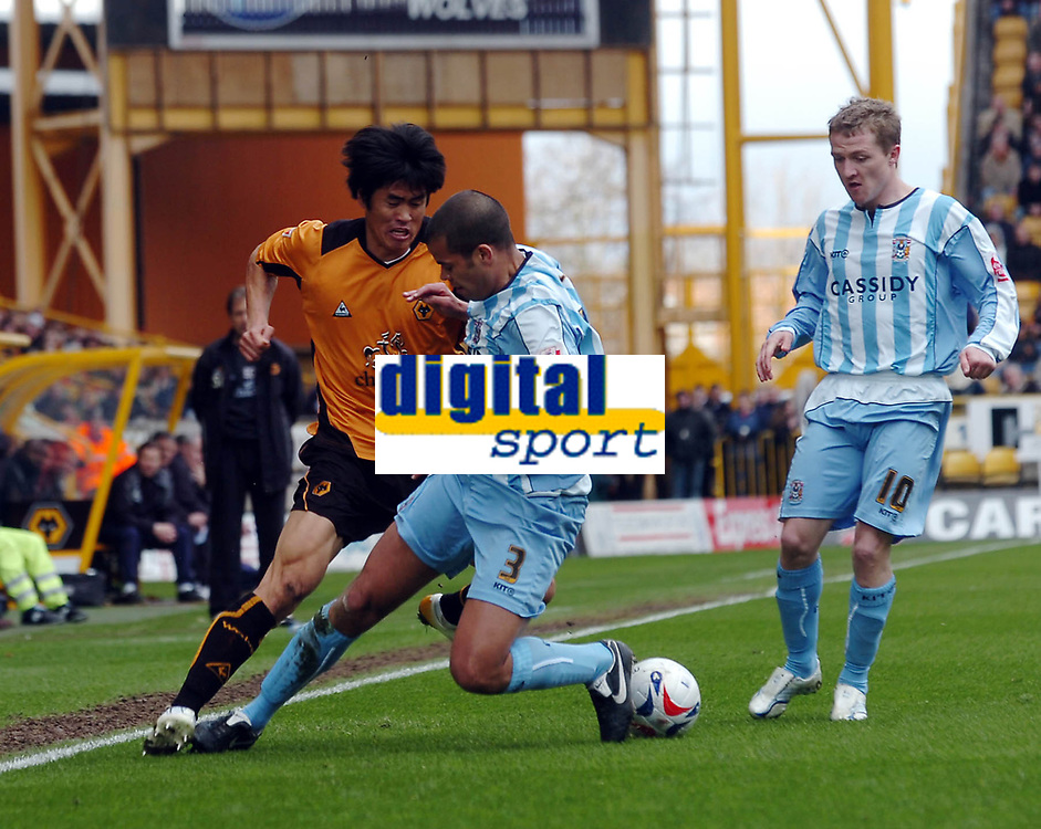 Photo: Kevin Poolman.<br />Wolverhampton Wanderers v Coventry City. Coca Cola Championship. 08/04/2006. Wolves player Ki-Hyeon Seol goes past Marcus Hall.