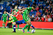 14.09.13. Brondby, Denmark.Salam Shakir of Irak is chased by Angelo Henriquez of Chile during the international friendly match at the Brondby Stadium in Denmark.Photo: © Ricardo Ramirez