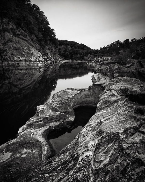 A 13-second exposure of a pothole in the rocks along the shores of the Potomac River, Maryland. About a mile downstream from Great Falls.