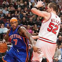 17 December 2009: New York Knicks forward Al Harrington drives past Chicago Bulls center Brad Miller during the Chicago Bulls 98-89 victory over the New York Knicks at the United Center, in Chicago, Illinois, USA.