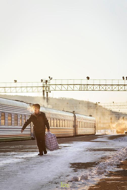 Passenger on the platform at Tynda station Amur region. Siberia, Russia