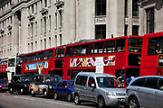 TRaffic including double decker busses, taxis and cars on regent Street, London. This is a highly congested area.