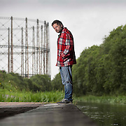 Kenny Anderson by the Forth and Clyde Canal in Maryhill, Glasgow. He is known primarily by his stage name: King Creosote;  an independent singer-songwriter from Fife, Scotland. Picture Robert Perry  for The Times 5th August 2015<br /> <br /> Must credit photo to Robert Perry<br /> FEE PAYABLE FOR REPRO USE<br /> FEE PAYABLE FOR ALL INTERNET USE<br /> www.robertperry.co.uk<br /> NB -This image is not to be distributed without the prior consent of the copyright holder.<br /> in using this image you agree to abide by terms and conditions as stated in this caption.<br /> All monies payable to Robert Perry<br /> <br /> (PLEASE DO NOT REMOVE THIS CAPTION)<br /> This image is intended for Editorial use (e.g. news). Any commercial or promotional use requires additional clearance. <br /> Copyright 2014 All rights protected.<br /> first use only<br /> contact details<br /> Robert Perry     <br /> 07702 631 477<br /> robertperryphotos@gmail.com<br /> no internet usage without prior consent.         <br /> Robert Perry reserves the right to pursue unauthorised use of this image . If you violate my intellectual property you may be liable for  damages, loss of income, and profits you derive from the use of this image.