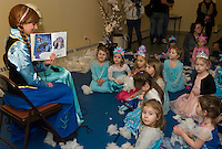 Little princesses gather around to read the story Frozen during Anna and Elsa's Tea Party at the Gilford Community Center Saturday morning.  (Karen Bobotas/for the Laconia Daily Sun)