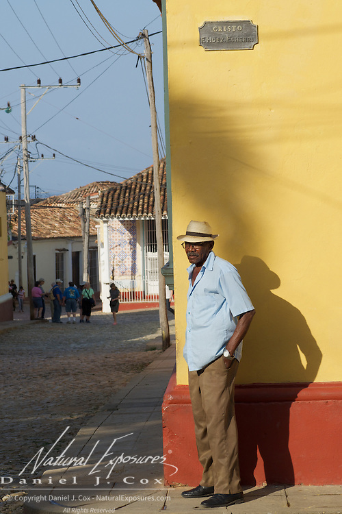 Juan waiting for his band mates in the town plaza in Trinidad, Cuba.