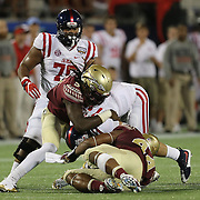]Mississippi Rebels quarterback Chad Kelly (10) gets sacked during an NCAA football game between the Ole Miss Rebels and the Florida State Seminoles at Camping World Stadium on September 5, 2016 in Orlando, Florida. (Alex Menendez via AP)