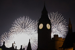 © Licensed to London News Pictures. 01/01/2017. London, UK. Fireworks explode behind Big Ben shortly after midnight to mark the start of the New Year. Photo credit : Vickie Flores/LNP