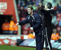 Photo: Jonathan Butler.<br />Southampton v Ipswich Town. Coca Cola Championship. 24/02/2007.<br />George Burley (rt) Southampton manager and Jim Magilton Ipswich Manager (lf) give direction to their player from the touchline.