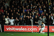Swansea city's Chico Flores  celebrates with the home fans after he scores his sides 2nd goal. Barclays Premier league, Swansea city v Fulham match at the Liberty Stadium in Swansea, South Wales on Tuesday 28th Jan 2014.<br /> pic by Andrew Orchard, Andrew Orchard sports photography.