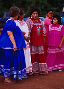 Anna Goseyun among women at her daughter, Carla's, White Mountain Apache Traditional Sunrise Ceremony, July 7-9, 1990, Whiteriver, Arizona.  Please Note: A small extra licensing fee needs to be paid to the Goseyun Family for usage of this photo. Contact Fred Hirschmann for more information. Thanks.