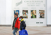 23rd February, Cheltenham, England. Shoppers walking past The Botanist, a bar and restaurant in The Brewery Quarter during the third national lockdown in England.