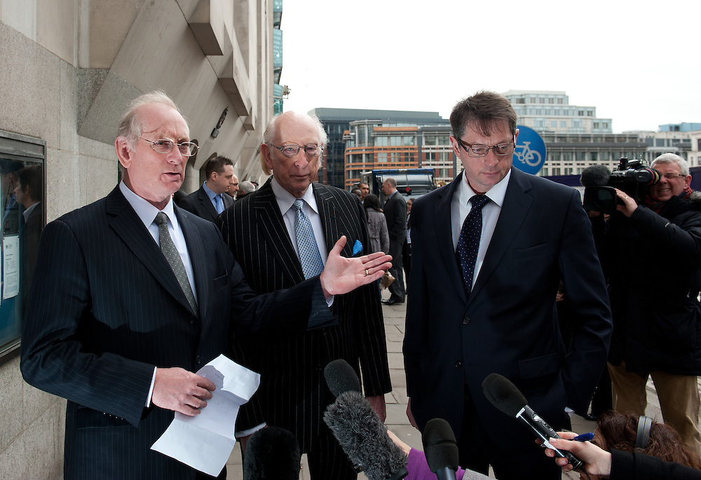 From Left to Right son Trevor Reeves, Father Maurice Reeves & other son Graham Reeves give a statement to press  outside about losing their 140 year old family furniture business at The Old Bailey in London  on February 24th 2012..Today Gordon Thompson pleaded guilty  to setting the Reeves furniture shop on fire on August 8th 2011 during the Croydon riots. ...Photo Ki Price..