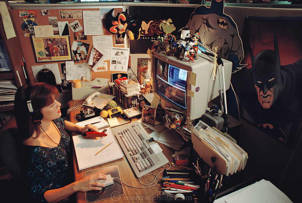 """K. Schneider, Technical Director, in her office of Pacific Data Images (PDI) in Sunnyvale, California.  1992. The company does computer animation and digital film effects: morphing. In 1996 PDI began collaborating with DreamWorks SKG, which then acquired PDI in 2004. .Creating believable 3D animated characters (War Games) and seamless transformations known as morphing (""""Black and White"""" and """"She's Mad""""), PDI has been at the forefront of computer imagery. The studio pushed the boundaries of morphing in Michael Jackson's video """"Black or White"""" with a sequence of twelve dynamic transformations of moving characters. In the innovative David Byrne video """"She's Mad,"""" PDI pioneered the technology called performance animation, capturing the motion of David Byrne and infusing an animated character with his distinctive motion. ."""
