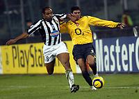 Photo: Chris Ratcliffe.<br />Juventus v Arsenal. UEFA Champions League. Quarter-Finals. 05/04/2006. <br />Jose Antonio Reyes of Arsenal gets away from Emerson of Juventus