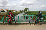 two locals in their bicycles above the Almonda river near Jose Saramago's birth place Aldeia da Azinhaga, central Portugal . Portuguese Nobel Prize of Literature, Jose Saramago, died at his house in Lanzarote on June 18. PAULO CUNHA/4SEEPHOTO