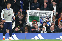 8 May 2017 - Premier League Football - Chelsea v Middlesbrough<br /> A fan holds up a sign reading John Terry I came all the way to Algeria to say thank you, more than 700 matches, 14 trophies, you deserve the best as John Terry of Chelsea passes by<br /> Photo: Charlotte Wilson