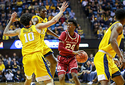Feb 2, 2019; Morgantown, WV, USA; Oklahoma Sooners guard Jamal Bieniemy (24) is pressured during the first half against the West Virginia Mountaineers at WVU Coliseum. Mandatory Credit: Ben Queen-USA TODAY Sports