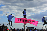 Direct action by a number of environmental groups on the Coryton Oil refinery ( Crude Awakening)