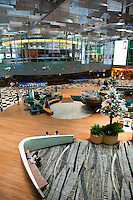 Changi Airport in Singapore is usually voted in the top five airports in the world, and for many years it maintained its status as Number One.  Why?  Thoughtful design, comfort, amenities and services that other airports don't bother to provide.  In addition to practical services like: barber shop, supermarkets, convenience stores, and hte usual shopping venues, Changi has much more.  Feeling poorly?  Changi has a medical clinic.  Bored?  There is a movie theatre,  art stations to stretch your creativity while in transit.  Tired?  Try out one of the Snooze Chairs, or comfortable armchairs to read or nap.  Plenty of restaurants to choose from, from food courts to high end dining.  There are also prayer rooms, free wi-fi throughout all terminals and even plenty of smoking rooms that manage to not make you feel like you're in detention.