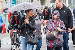 © Licensed to London News Pictures. 16/06/2019. Brighton, UK. Members of the public shelter from the rain as cold and wet weather is hitting Brighton and Hove. Photo credit: Hugo Michiels/LNP