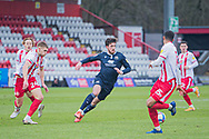 Morecambe forward Cole Stockton (9) travels with the ball and takes on Stevenage midfielder Max Granville (34), Stevenage defender Terence Vancooten (15) and Stevenage midfielder Arthur Read (19) during the EFL Sky Bet League 2 match between Stevenage and Morecambe at the Lamex Stadium, Stevenage, England on 6 February 2021.