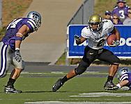 Colorado running back Hugh Charles (2) rushes up field against Kansas State's Blake Seiler (L) in the first half at KSU Stadium in Manhattan, Kansas, October 29, 2005.  The Buffaloes beat K-State 23-20.