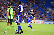 Craig Noone of Cardiff city ® scores his teams 1st goal from a free kick.  Capital One cup match, 1st round, Cardiff city v AFC Wimbledon at the Cardiff city stadium in Cardiff, South Wales on Tuesday 11th August  2015.<br /> pic by Andrew Orchard, Andrew Orchard sports photography.