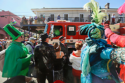 09 February 2016. New Orleans, Louisiana.<br /> Mardi Gras Day. Revelers in bright and colourful costumes fill the French Quarter. A fire engine passes the crowd.<br /> Photo©; Charlie Varley/varleypix.com