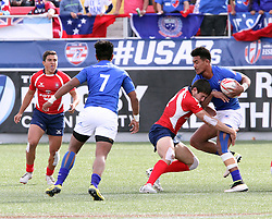 March 5, 2017 - Las Vegas, Nevada, United States of America - Chilean rugby player Martin Raddatz tackles  Samoan player Joe Perez during the 2017 USA Sevens International Rugby Tournament game between Chile and Somoa on March 4, 2017  at Sam Boyd  Stadium  in Las Vegas, Nevada (Credit Image: © Marcel Thomas via ZUMA Wire)
