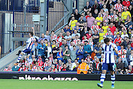 West Brom's Liam Ridgewell (6) celebrates in front of Sunderland fans after he scores his sides 2nd goal. Barclays Premier league match, West Bromwich Albion v Sunderland at the Hawthorns in West Bromwich, England on Sat 21st Sept 2013. pic by Andrew Orchard, Andrew Orchard sports photography,