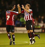 Photo: Aidan Ellis.<br /> Sheffield Utd v Luton Town. Coca Cola Championship.<br /> 01/11/2005.<br /> Sheffield's Phil Jagielka celebrates his goal with Paul Ifill