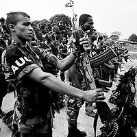 AUC fighters on parade in a village near La Dorada, Putumayo.<br />