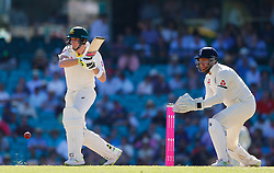 Australia's Steve Smith hits a boundary as Jonny Bairstow looks on during day two of the Ashes Test match at Sydney Cricket Ground.