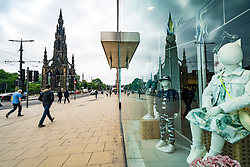 Edinburgh, Scotland, UK. 17 June, 2020. Views from Edinburgh city centre before expected relaxation of covid-19 lockdown by Scottish Government. Pictured; Reflection of Scott Monument on Princes Street in closed store window.  Iain Masterton/Alamy Live News