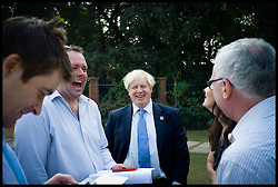 London Mayor Boris Johnson talks to Journalist at the High Commision after he handed over the London 2012 Olympic cauldron petals to Indian Olympians. The petals which were part of the Thomas Heatherwick designed cauldron which burnt throughout the Olympic and Paralympic Games will be given to every competing nation, on the second day of a six-day tour of India, where he will be trying to persuade Indian businesses to invest in London, Monday November 26, 2012. Photo by Andrew Parsons / i-Images