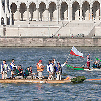 Man holds a polish flag on a boat on river Danube in front of the Parliament as part of the Hungarian rotational EU presidency closing celebrations in Budapest, Hungary on June 25, 2011. ATTILA VOLGYI.Polish participants of the event celebrate that Hungary will hand the rotational EU presidency to Poland after finishing their half year term.