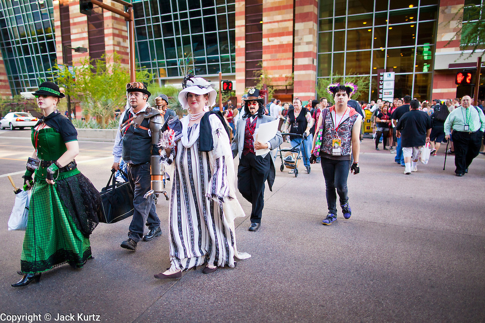 27 MAY 2011 - PHOENIX, AZ: Comicon participants cross a street in downtown Phoenix Friday. Phoenix Comicon opened Thursday and featured a Zombie Walk through downtown Phoenix Friday night. Hundreds of people participated in the Zombie Walk, both as Zombies and as Zombie hunters. This year's Comicon includes appearances by Leonard Nimoy (Star Trek), Adam Baldwin (Firefly and Chuck), Stan Lee (Marvel Comics), Nicholas Brendon (Buffy the Vampire Slayer) and others. Activities include costuming workshops, role playing games and a Geek Prom.     Photo by Jack Kurtz